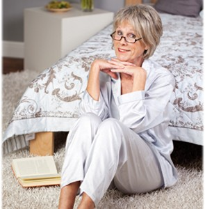 pux-on-older-woman-sitting-on-bedroom-floor